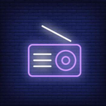 Radio set neon icon. Receiver with antenna