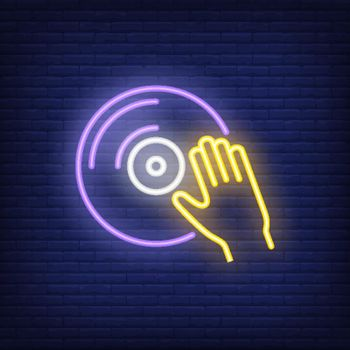 Vinyl disk with hand neon sign