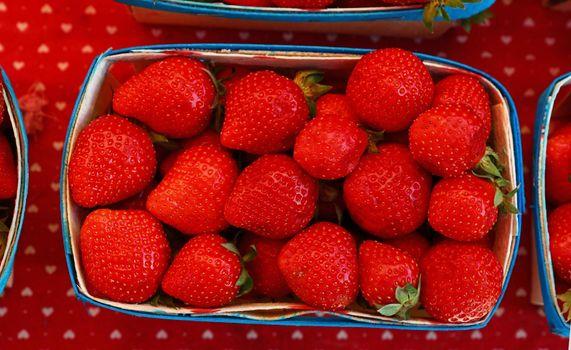Close up fresh strawberry on retail display