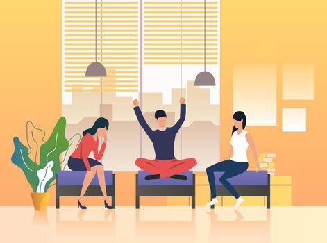 Colleagues having break in lounge