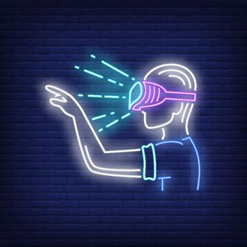 Guy wearing VR goggles neon sign