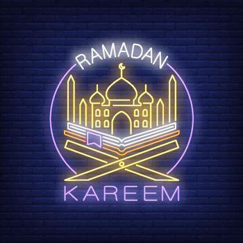 Ramadan Kareem neon text with mosque and Koran in circle