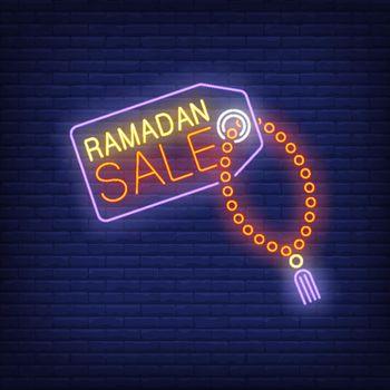 Ramadan Sale neon text on tag with prayer beads