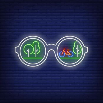 Sunglasses with green trees and bicycle reflection neon sign