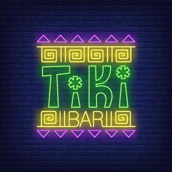 Tiki bar neon text with ethnic ornament
