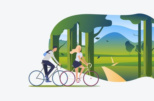 Man and woman riding bicycles with green landscape in background