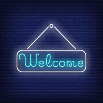 Welcome neon lettering on tablet