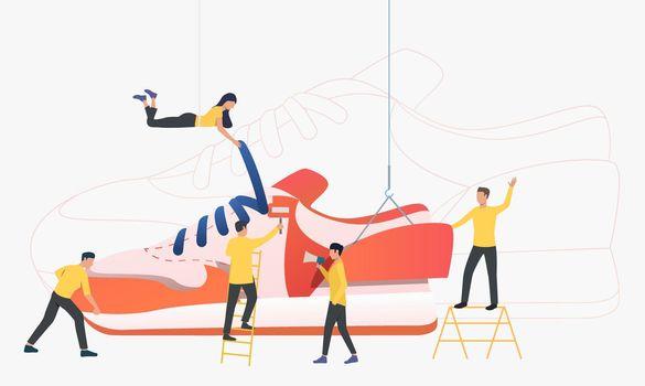 Team of workers producing sneakers