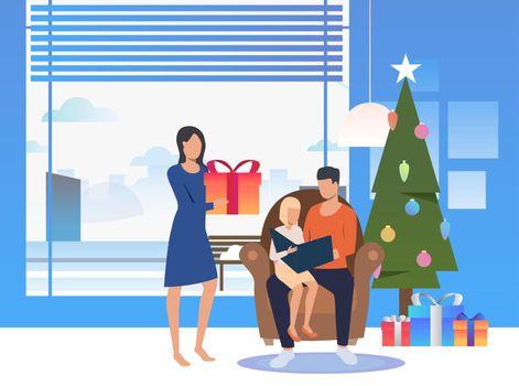 Happy family enjoying Christmas Eve