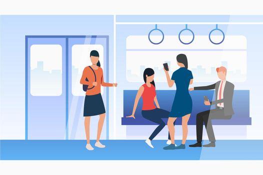 People using mobile phones in subway train