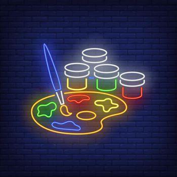 Artist paints neon sign