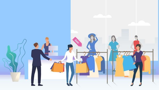 Shoppers choosing and buying clothes in shop