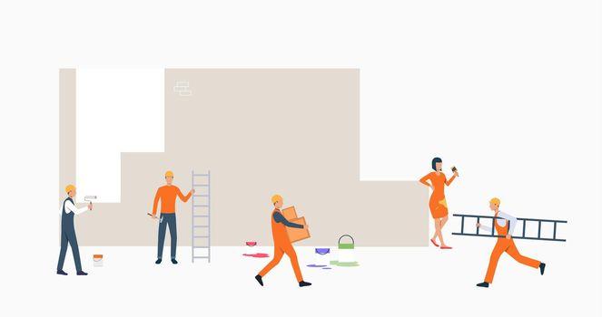 Decorators painting wall