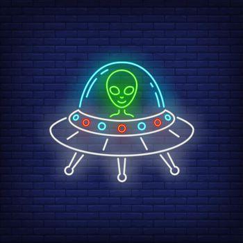 Alien in flying saucer neon sign