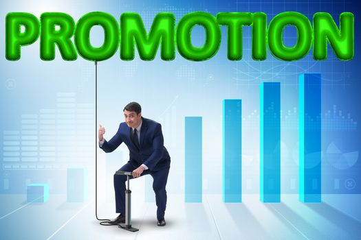 Businessman pumping promotion in business concept