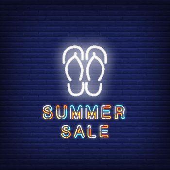 Summer sale neon text with flip-flops