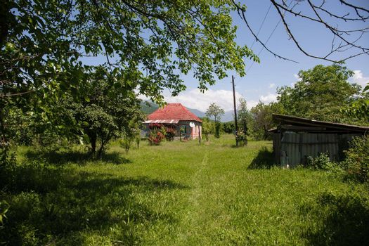 Picture of beautiful village house with garden. Azerbaijan village in summer time. Zaqatala district