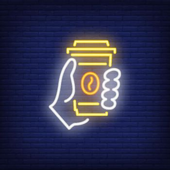 Hand holding disposable coffee cup neon sign