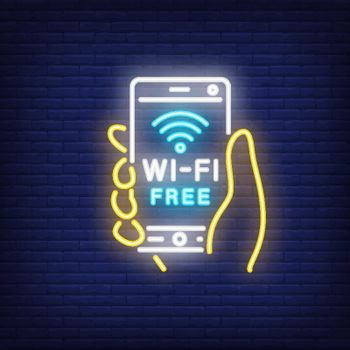 Hand holding smartphone with wi-fi free neon text
