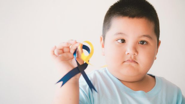 Down's syndrome holding ribbon