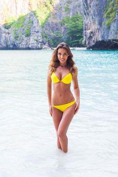 Beautiful woman in bikini on beach at Maya bay, Thailand