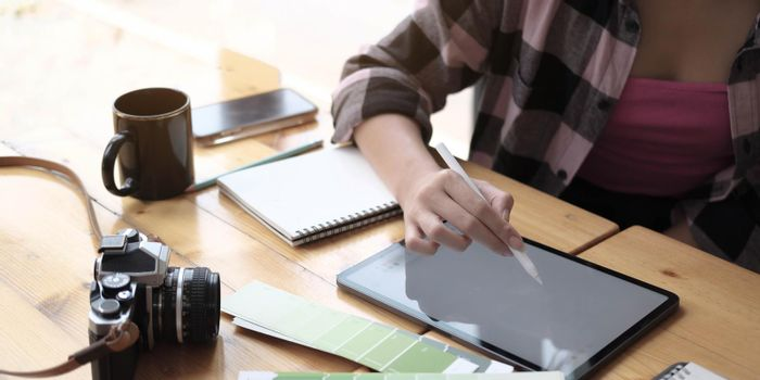 Close up of female hands and laptop with blank screen.