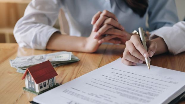 Real estate agent sign a contract documents agreement with customer to sign contract