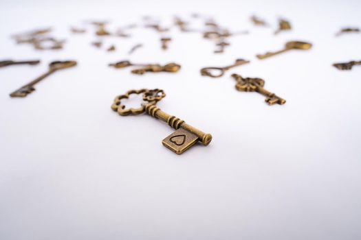 Close up of vintage key with a heart engraving
