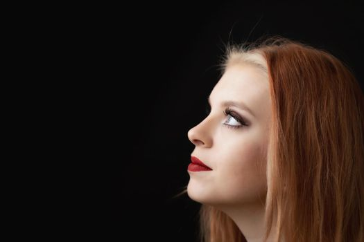 Head of beautiful redhead young woman.