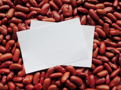 Closeup of White tag on Raw Red Kidney Beans Background