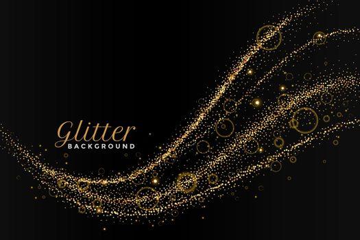 glitterting dust golden trail on black background