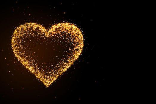 glowing golden glitter heart on black background