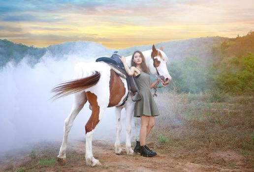 Woman With Horse Standing On Land