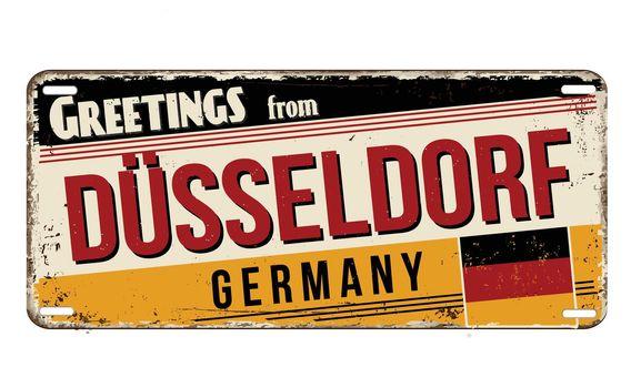 Greetings from Düsseldorf vintage rusty metal plate