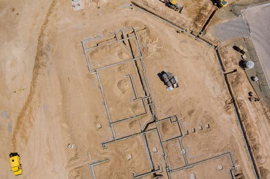 Aerial view construction work in the laying pipes in the foundation for new residential complex buildings