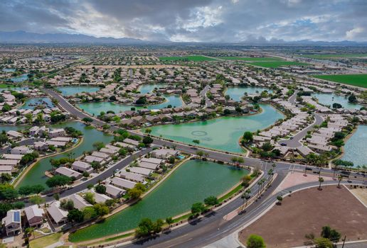 Overlooking desert of the many small ponds near Avondale a small town a of rugged mountains near of state capital Phoenix Arizona US