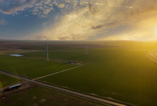 A wind farm at sunset in Texas. Silhouette of wind turbines