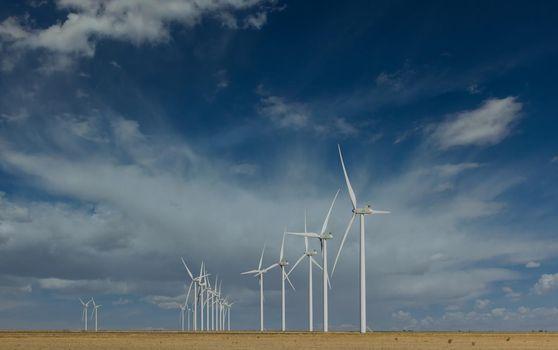 Texas wind turbine farms in the beautiful sky in West Texas