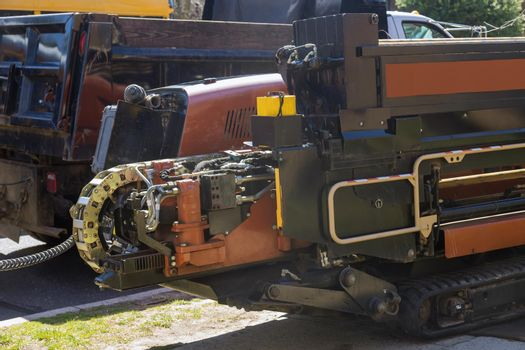 A trencher machine used to dig trenches for laying pipes on under construction site