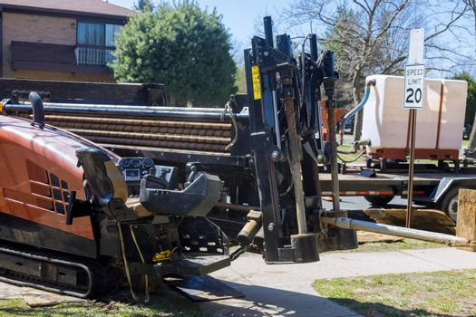 Under construction site trencher machine used to dig trenches for laying electrical cables for installing