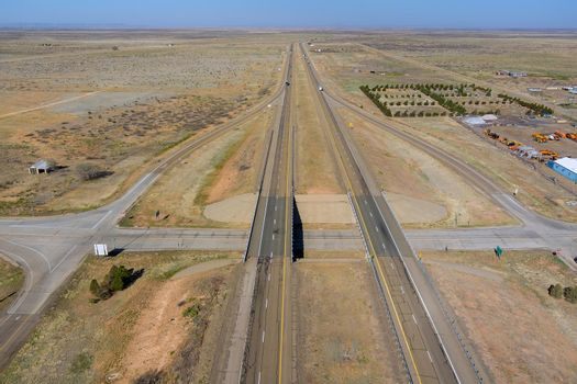 Desert road aerial panorama of a new two lane road surrounded by desert landscape near San Jon New Mexico US