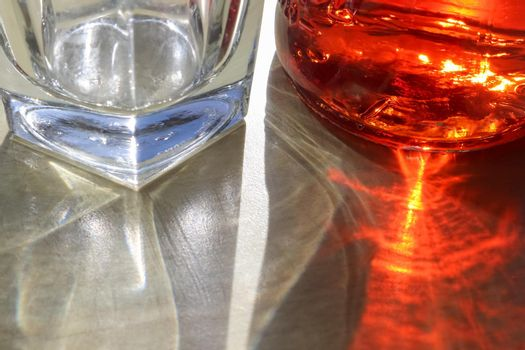 Sunlight shining through a drinking glas showing caustic light effects.