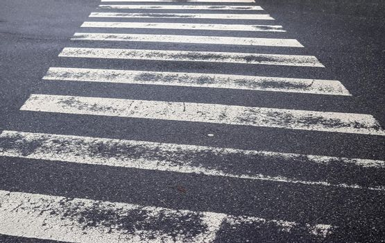 White painted pedestrian zebra crossing on a road in Europe.