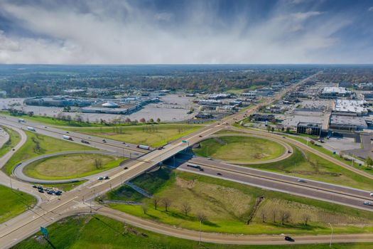 High drone view above highways, interchanges the roads on interstate takes you on a fast transportation highway in Fairview Heights Illinois US