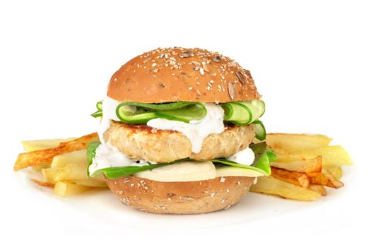 Fishburger fish burger with cod cutlet cucumber lettuce goat cheese dzatziki tartarus sauce on grain cereal bread and french fries on plate isolated on white background