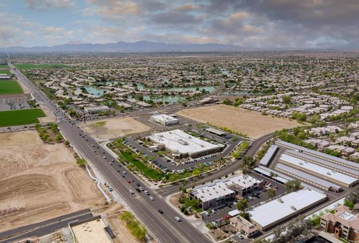 Aerial overlooking desert small town a Avondale city of beautiful highway Arizona on the mountain with traffic line in Interstate expressway near Phoenix AZ USA