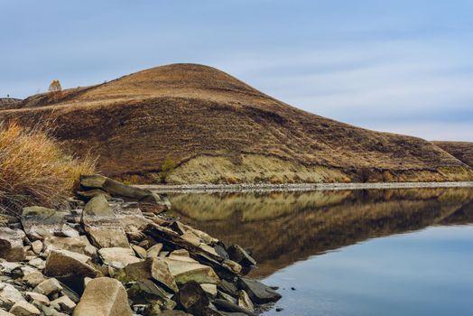 Hills on lakes coastline