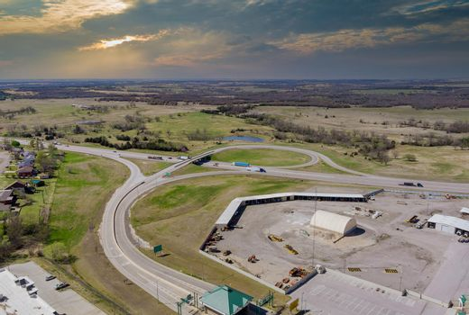 High drone view above highways, interchanges the roads on interstate takes you on a fast transportation highway in Stroud Oklahoma US