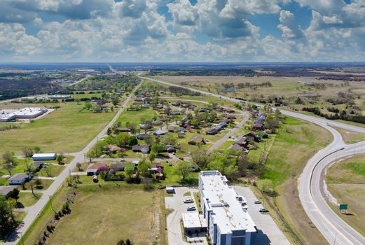 Above transport junction road aerial view with car movement transport industry near residential district at suburban development with a Stroud Oklahoma USA