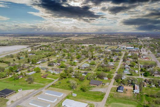 Landscape scenic aerial view of a suburban settlement in USA with a beautiful town detached houses the Stroud Oklahoma USA